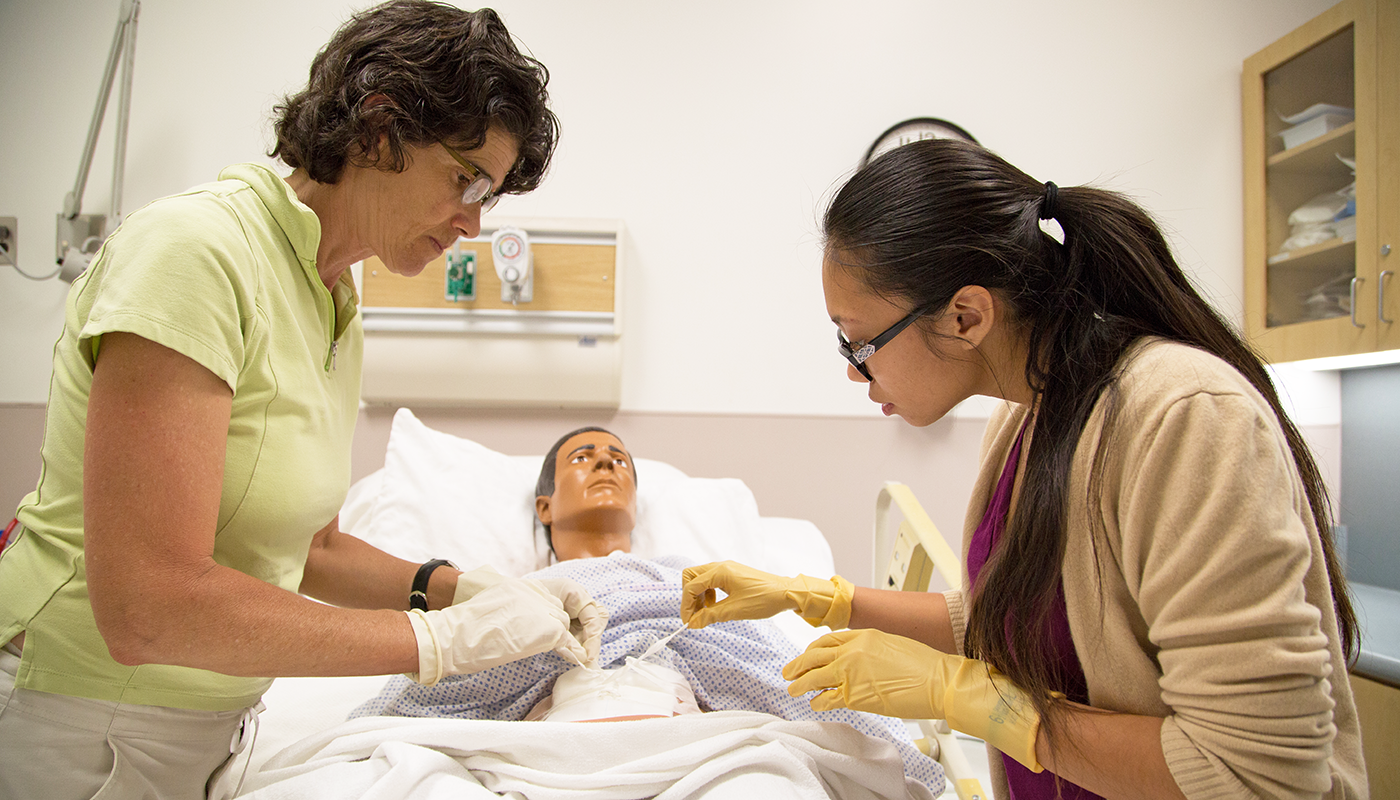 Two SBCC nursing students with a dummy.